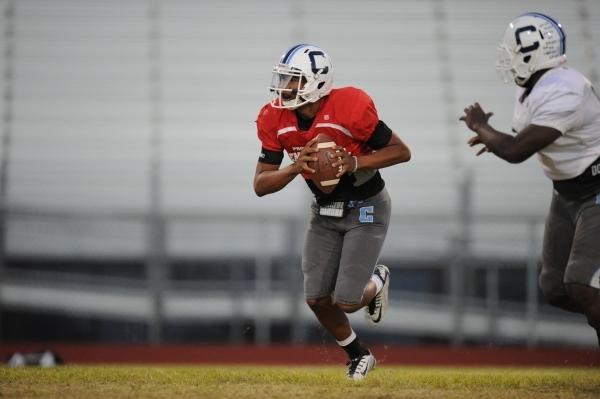 Centennial quarterback Jamaal Evans runs the ball during their football practice at Centenni ...