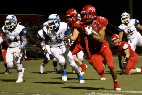 Arbor View High School running back Curtis Jones takes the ball downfield for a touchdown ag ...