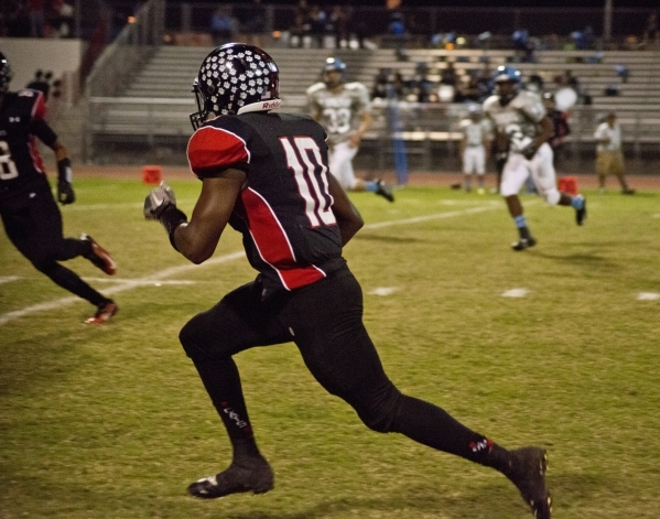 Las Vegas' Elijah Hicks (10) sprints up the sideline during their prep football game a ...
