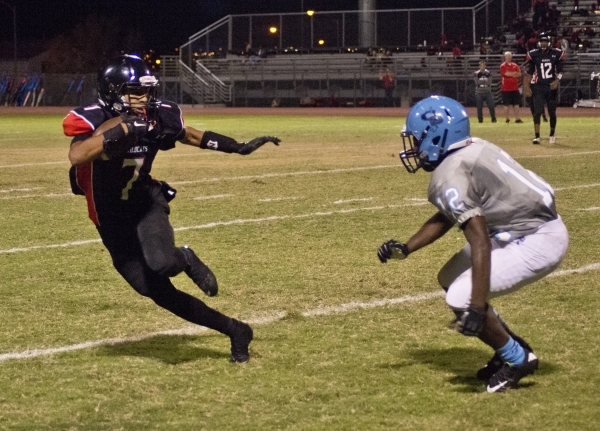 Canyon Springs' Jaleel Rogers (23) breaks a tackle during their prep football game at ...