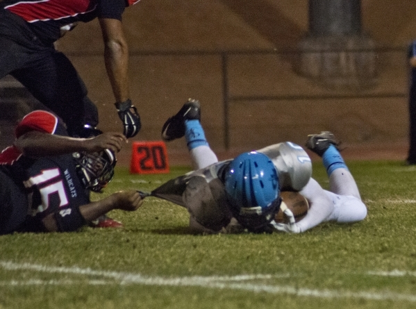 Canyon Springs' Diamante Burton (10) is tackled by Thomas Dorsey (15) during their pre ...