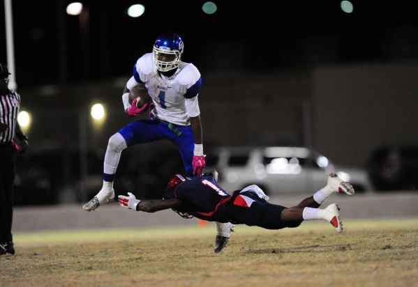 Green Valley Gators wide receiver Marquez Powell (1) breaks the tackle of Coronado Cougars d ...