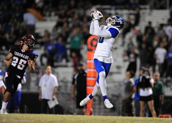 Green Valley Gators wide receiver Isiah Macklin catches a touchdown pass in front of Coronad ...