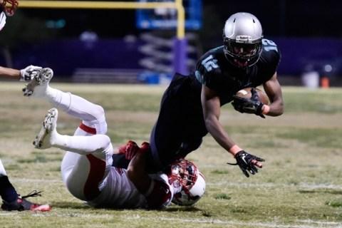 Silverado's Devion Clayton (12) dives for extra yardage as Liberty's Ethan Dedea ...