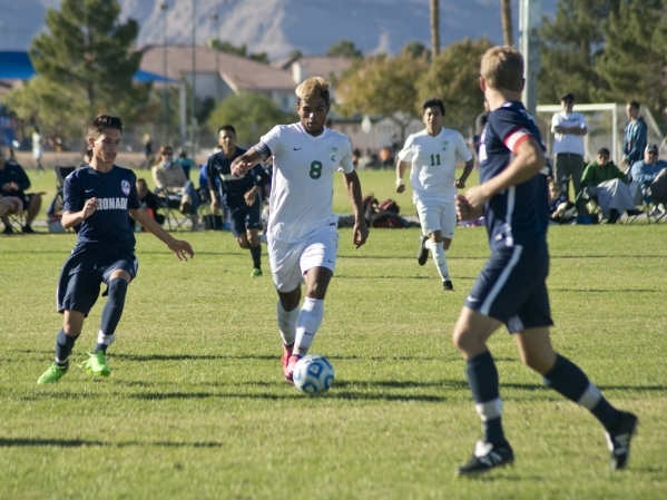 Green Valley's Ricardo Nunez (8) takes the ball up the field during the Sunrise Region ...