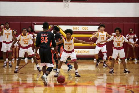 Del Sol defenders protect the court as Chaparral's Meshach Hawkins (35) drives the bal ...