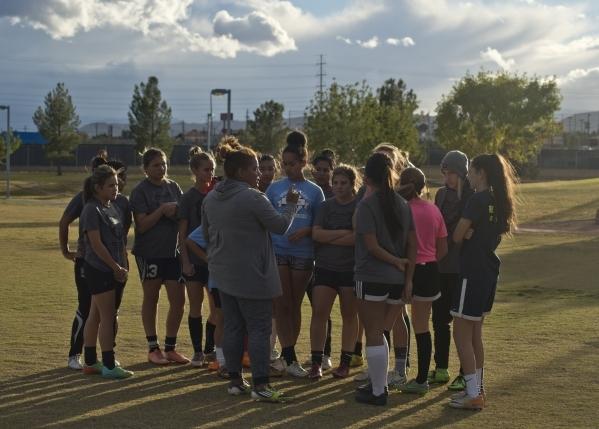 Spring Valley High School girls soccer coach Yamilza Rivera speaks to her players during pra ...