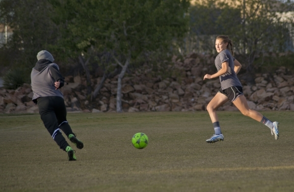 Sahana Bojorquez, right, passes the ball to Samantha Meyers during practice on the Spring Va ...