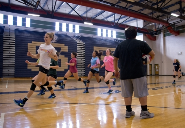 Players on the Shadow Ridge girls volleyball run laps during practice at Shadow Ridge High S ...