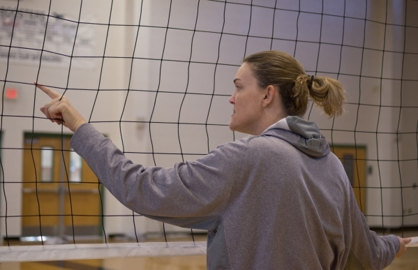 Shadow Ridge girls volleyball coach Karissa Guthrie stands at the net during practice at Sha ...