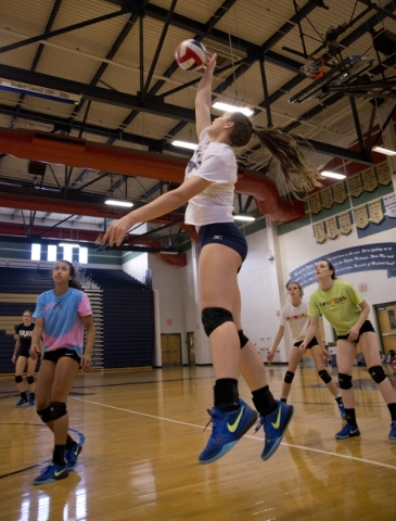 Shadow Ridge girls volleyball player Whittnee Nihipali hits the ball during practice at Shad ...