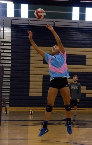 Shadow Ridge girls volleyball player Eadara Files sets the ball during practice at Shadow Ri ...
