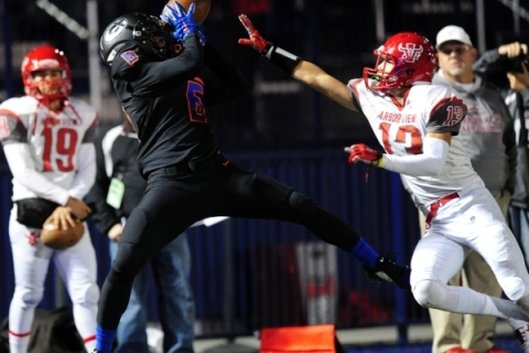 Bishop Gorman wide receiver Austin Arnold catches a pass for a first down in front of Arbor ...