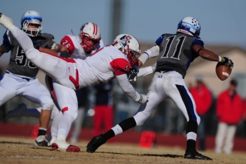 Liberty linebacker Kaimi Batoon (5) sacks Basic Wolves quarterback Aeneas McAllister (11) in ...