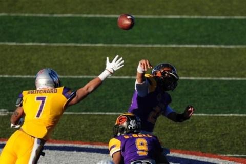 Sunset All-Stars quarterback Tanoa Alapati (21) throws an interception to Sunrise safety Zac ...