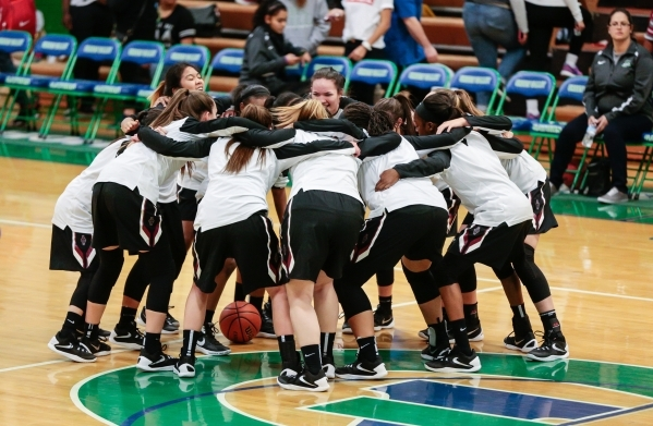 Desert Oasis players rally prior to the start of the basketball game against Green Valley at ...