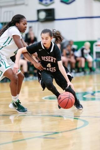 Desert Oasis freshman Brianna Clark (4) moves the ball down the court as Green Valley junior ...
