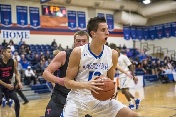 Bishop Gorman center Zach Collins (12) holds the ball while being defended by Timpview (Utah ...