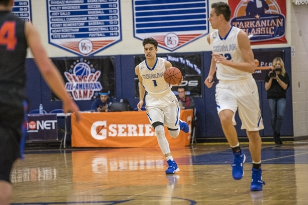Bishop Gorman guard Chase Nomaaea (1) moves with the ball against Timpview (Utah) during the ...
