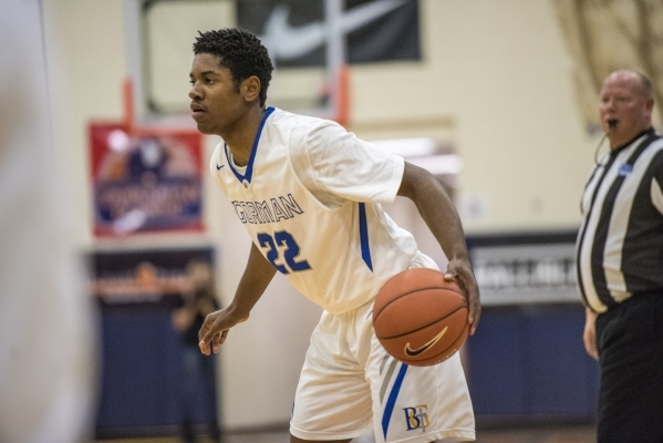 Bishop Gorman guard Christian Popoola Jr. (22) looks to make a play against Timpview (Utah) ...