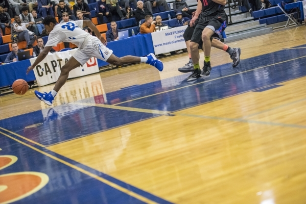 Bishop Gorman guard Christian Popoola Jr. (22) chases a ball while playing against Timpview ...