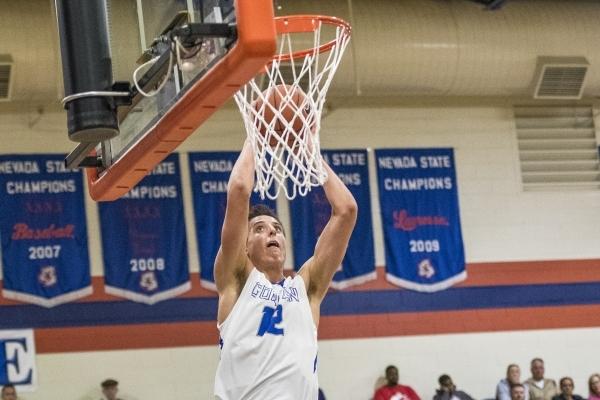 Bishop Gorman center Zach Collins (12) dunks the ball against Timpview (Utah) during the fir ...