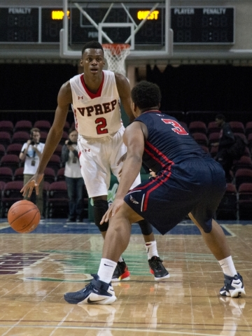 Victory Prep's Jarred Vanderbilt (2) attempts to move the ball past Findlay Prep&lsquo ...