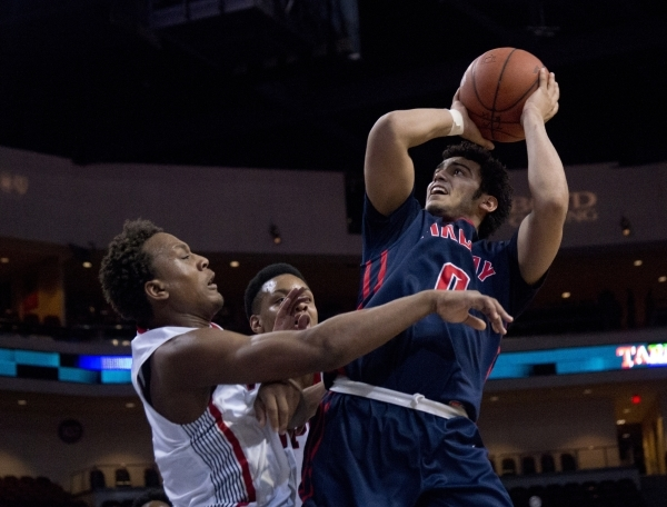 Findlay Prep's Markus Howard (0) attempts to put a shot over Victory Prep's John ...