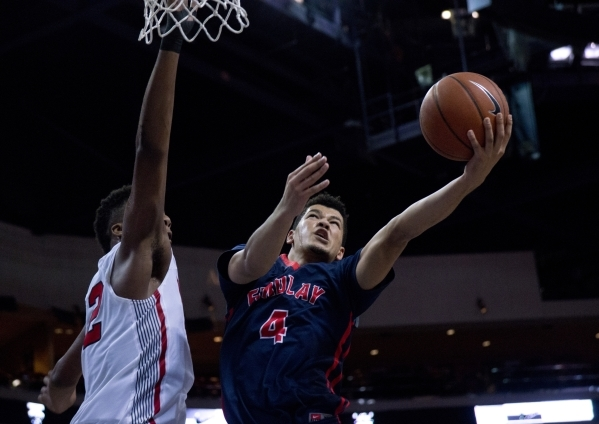 Findlay Prep's Skylar Mays (4) attempts to get the ball past Victory Prep's Jarr ...