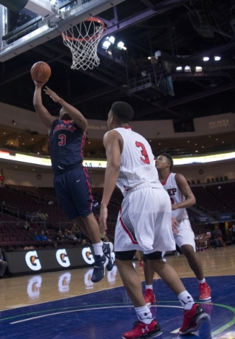 Findlay Prep's Carlos Johnson (3) takes the ball to the net during the fourth annual T ...