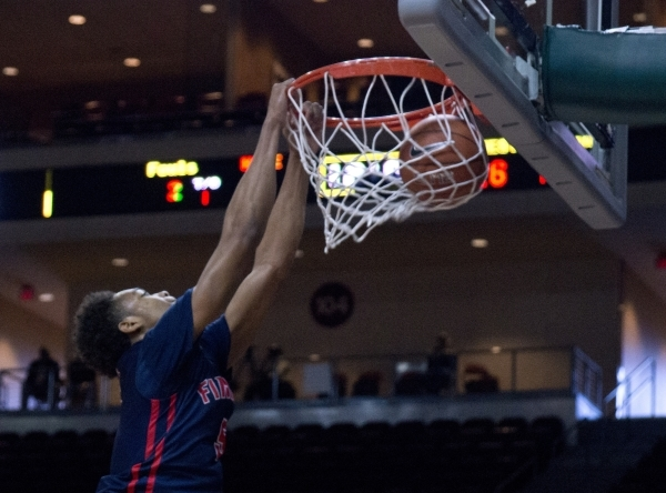 Findlay Prep's PJ Washington (5) dunks the ball during their game against Victory Prep ...