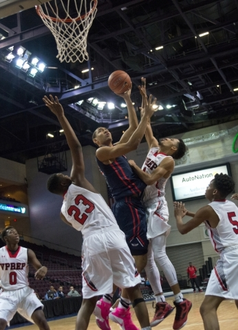 Findlay Prep's Tristan Clark (12) takes the ball to the net while being defended by Vi ...