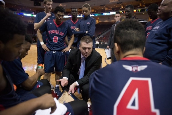Findlay Prep's head coach Andy Johnson talks to his team during a timeout during the f ...