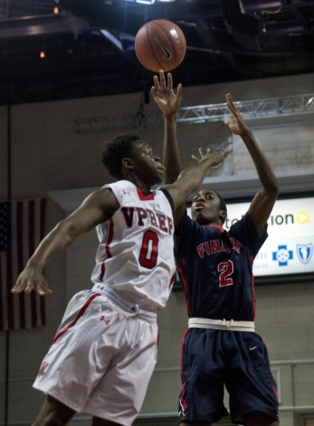 Findlay Prep's Shakwon Barrett (2) takes a shot at the net as Victory Prep's Ant ...
