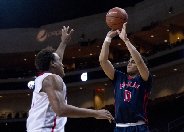 Findlay Prep's Markus Howard (0) attempts to put a three point shot over Victory Prep& ...