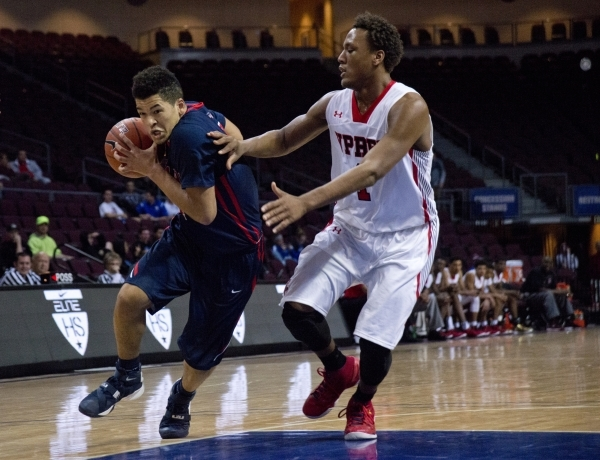 Findlay Prep's Skylar Mays (4) attempts to move the ball past Victory Prep's Joh ...