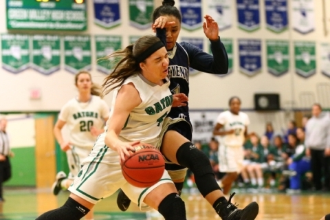 Green Valley's Ellee Barton (4) drives against Cheyenne's Dominique Hudson (1) d ...