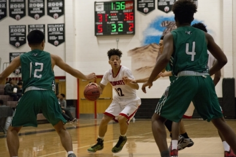 Las Vegas' Donovan Joyner (12) works the ball up the court during their game against ...