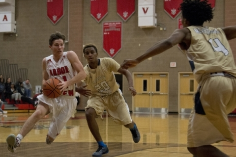 Arbor View's Jesse Vogel (11) drives to the basket as Shadow Ridge's Isaiah ...