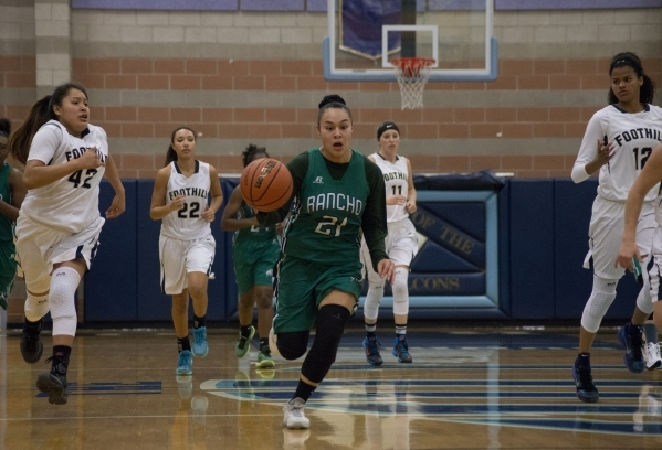 Rancho's Tatianna Lee (21) takes the ball up the court during their game at Foothill H ...