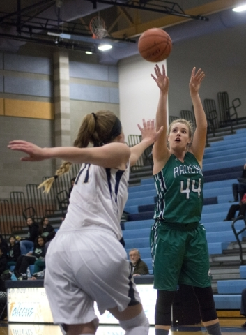 Rancho's Samantha Pochop (44) takes a shot over Foothillís Kylie Vint (11) during ...