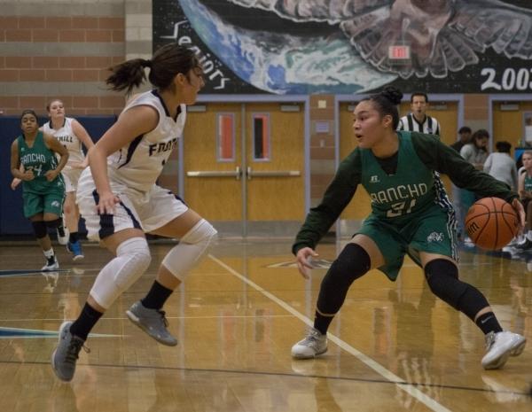 Rancho's Tatianna Lee (21) faces off against Foothillís Amanda Carducci (1) during ...