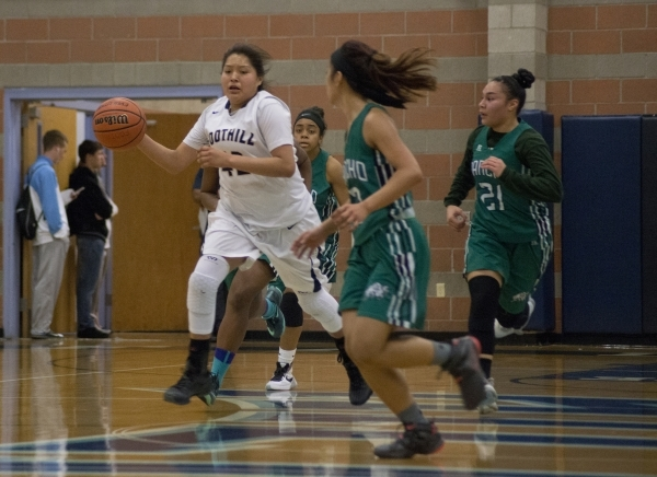 Foothill's Trinity Betoney (42) works the ball up the court during their home game aga ...