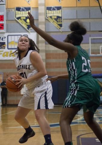Foothillís Bri Rosales (31) looks to take a shot at the basket as Rancho's Ashlynn ...