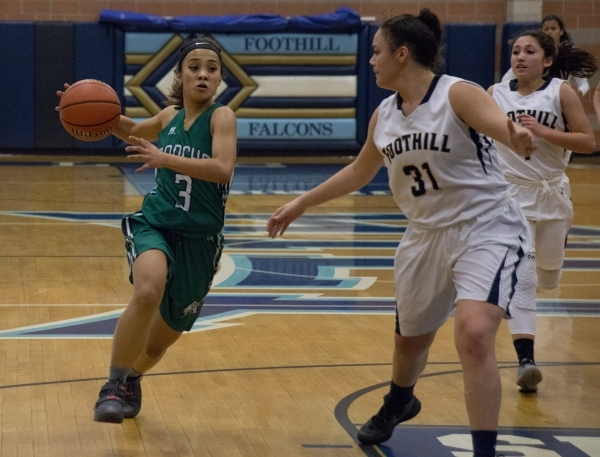 Rancho's Maureen Macato (3) looks to move the ball past Foothillís Bri Rosales (31) ...