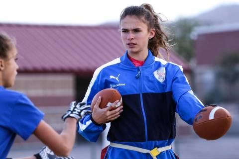 Coronado quarterback Caitlin Shannon, a 17-year-old junior, right, hands the ball off to tea ...