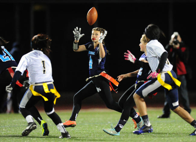 Centennial wide receiver Ashley Marshall catches a lateral pass against Foothill in the firs ...