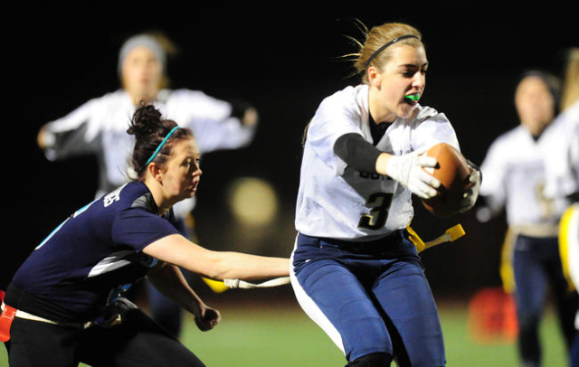 Centennial Courtney Reeves pulls the flag off of Foothill wide receiver Emily Mull (3) in th ...