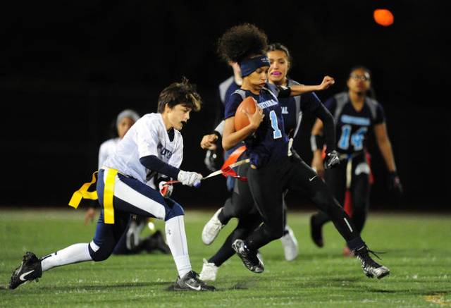 Foothill safety Alexis Farias, left, pulls the flag off of Centennial running back Aliyah Wy ...