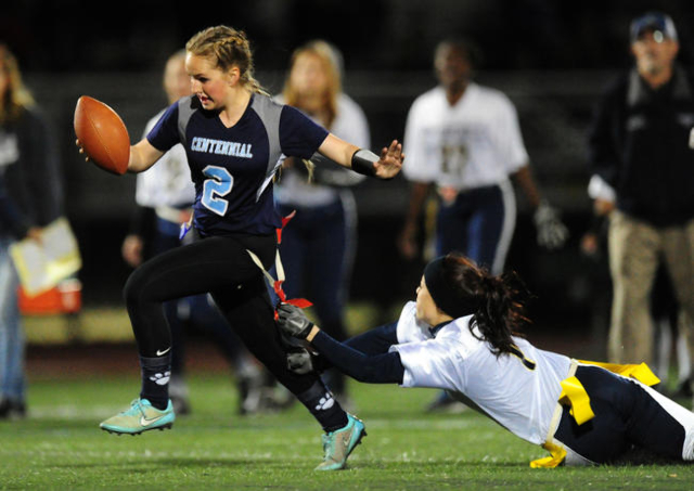 Foothill safety Sayonna Thunstrom, right, pulls the flag off of Centennial Halli Erickson in ...